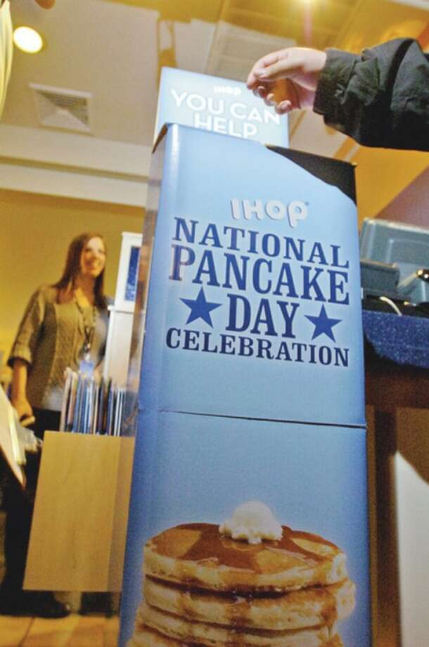The International House of Pancakes (IHOP) on Summer St in Stamford serves up free pancakes during IHOP's annual National Pancake Day. In return, diners were asked to make a voluntary donation to support ChildrenÕs Miracle Network Hospital, Maria Fareri Children's Hospital at Westchester Medical Center.
