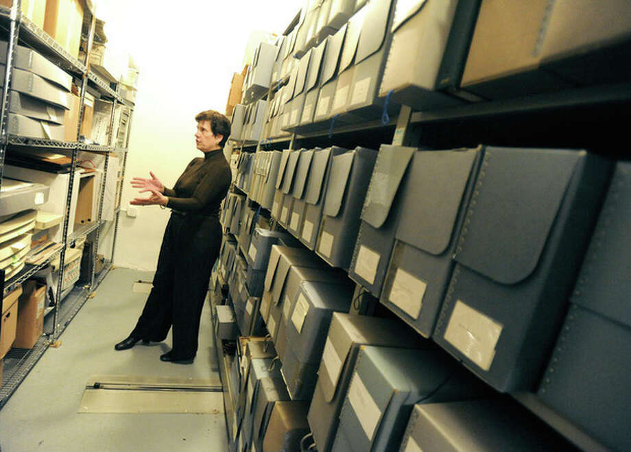 Hour photos / Matthew Vinci Susan Gunn Bromley, curator of the Norwalk Museum, shows where records of police, hospital and family genealogy are kept during a tour on Sunday.