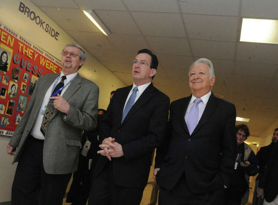 David Hay, principal of Brookside Elementary School and Norwalk Mayor Richard Moccia lead Connecticut Governor Dannel Malloy on a tour of the school Monday. hour photo/Matthew Vinci