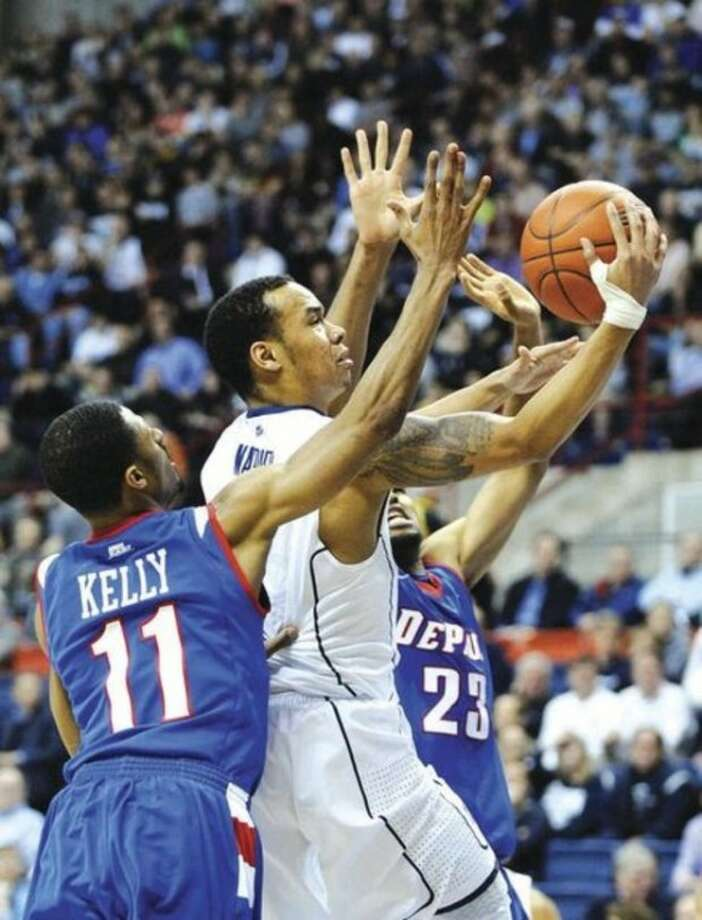 AP photoUConn's Shabazz Napier, center, drives past DePaul's Jeremiah Kelly (11) and Donnavan Kirk during the first half of Wednesday night's game at Gampel Pavilion. Napier led the Huskies to an 80-54 victory.