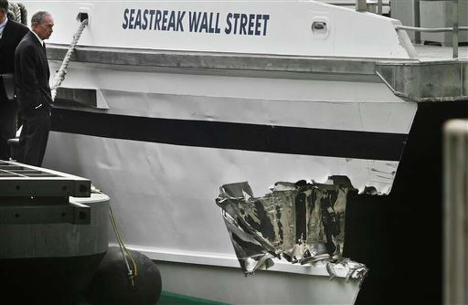 Mayor Michael Bloomberg surveys the damage to a passenger ferry after it crashed on Wednesday, Jan. 9, 2013 in New York. At least 57 people were injured, two critically, when a commuter ferry struck a dock in New York City's financial district, ripping open a right-side front corner. (AP Photo/Bebeto Matthews) / AP