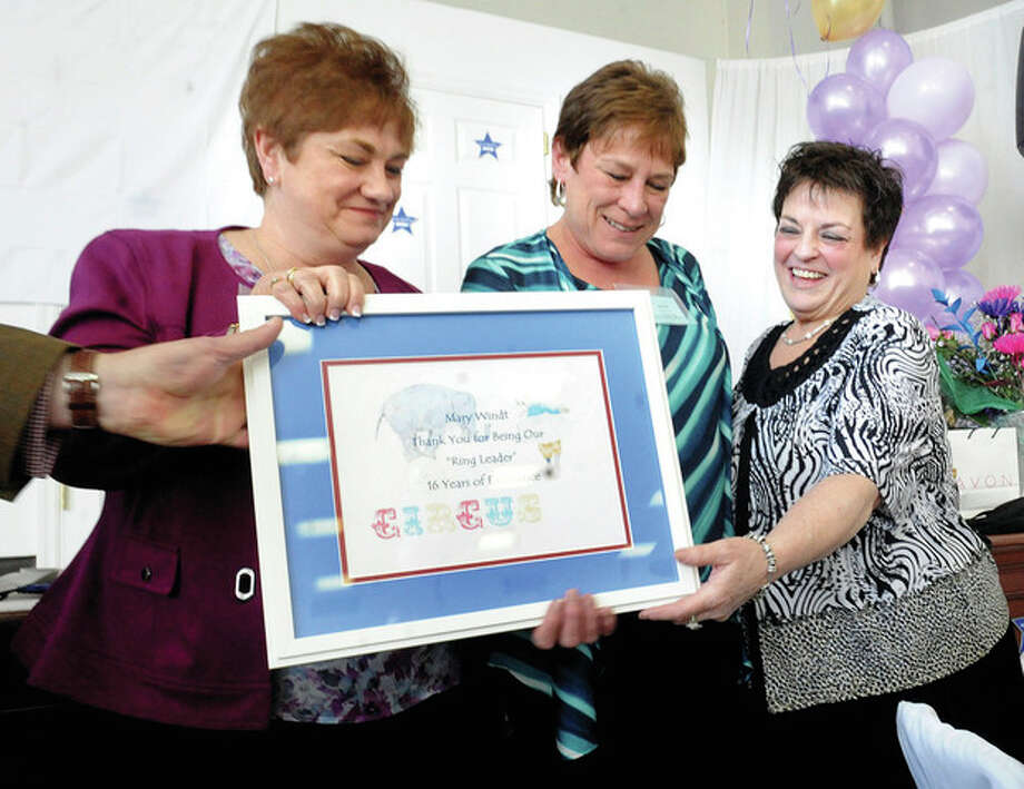 Hour photo / Matthew VinciOn the right, Executive Director Mary R. Windt gets a 'thank you' plaque presented by secretary Tori Zaccagnino and treasurer Anne Griesmer Sunday at The Marvin Under One Roof 15th anniversary celebration.