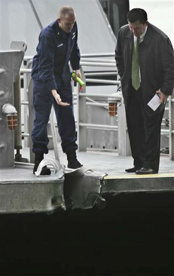 Investigators survey the damage to a passenger ferry after it crashed on Wednesday, Jan. 9, 2013 in New York. At least 57 people were injured, two critically, when a commuter ferry struck a dock in New York City's financial district, ripping open a right-side front corner. (AP Photo/Bebeto Matthews) / AP