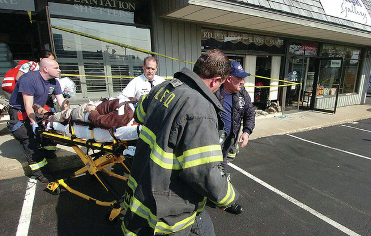 A female employee of Hunter Douglas Gallery who suffered injuries when a car smashed into her store is taken to the hospital Monday.