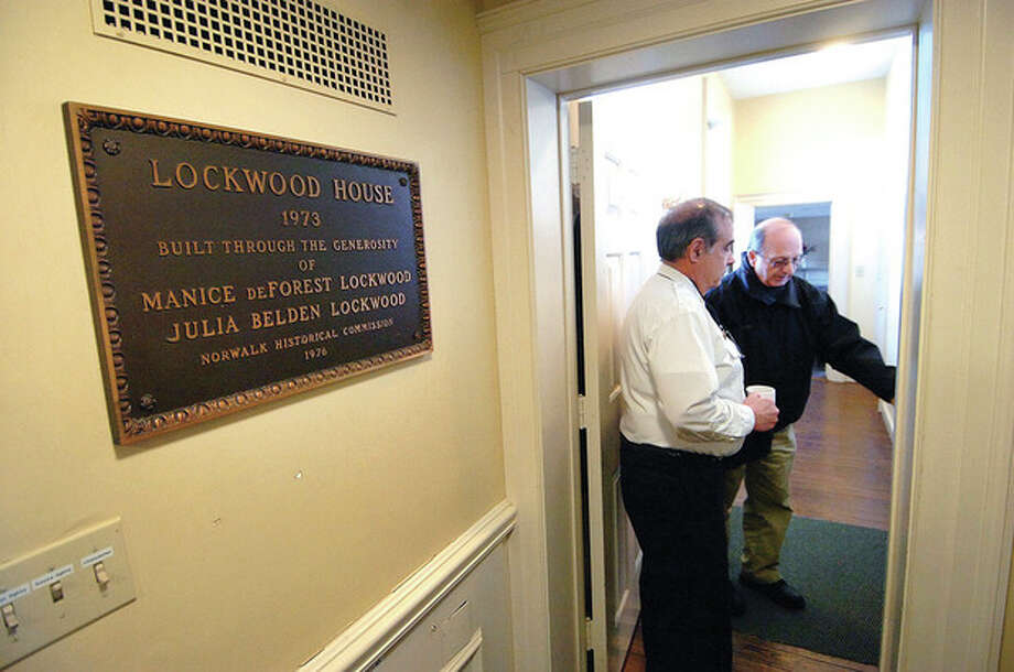 Hour photos / Alex von KleydorffNorwalk Fire Marshal Glenn Iannacone shows Ralph Bloom around the administrative offices at Lockwood House, 141 East Ave., where Norwalk Museum might wind up housing its collections. / © 2012 The Hour Newspapers/Alex von Kleydorff
