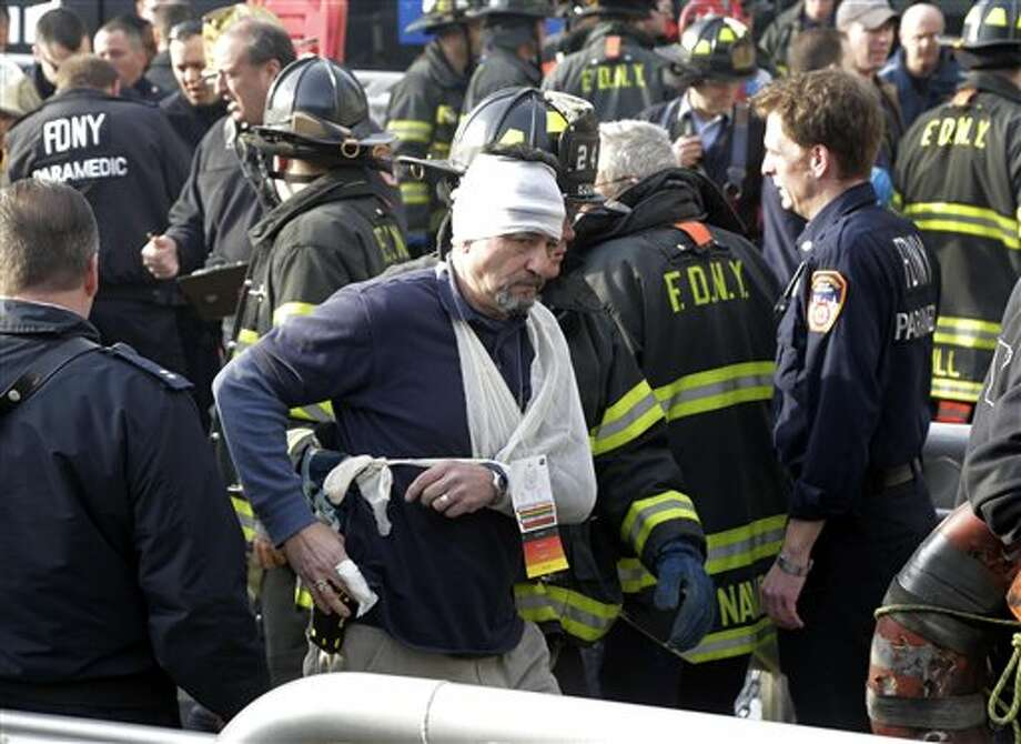 An injured passenger of the Seastreak Wall Street ferry is aided by New York City firefighters, in New York, Wednesday, Jan. 9, 2013. The ferry from Atlantic Highlands, N.J., banged into the mooring as it arrived at South Street in lower Manhattan during morning rush hour, injuring as many as 50 people, at least one critically, officials said. (AP Photo/Richard Drew) / AP