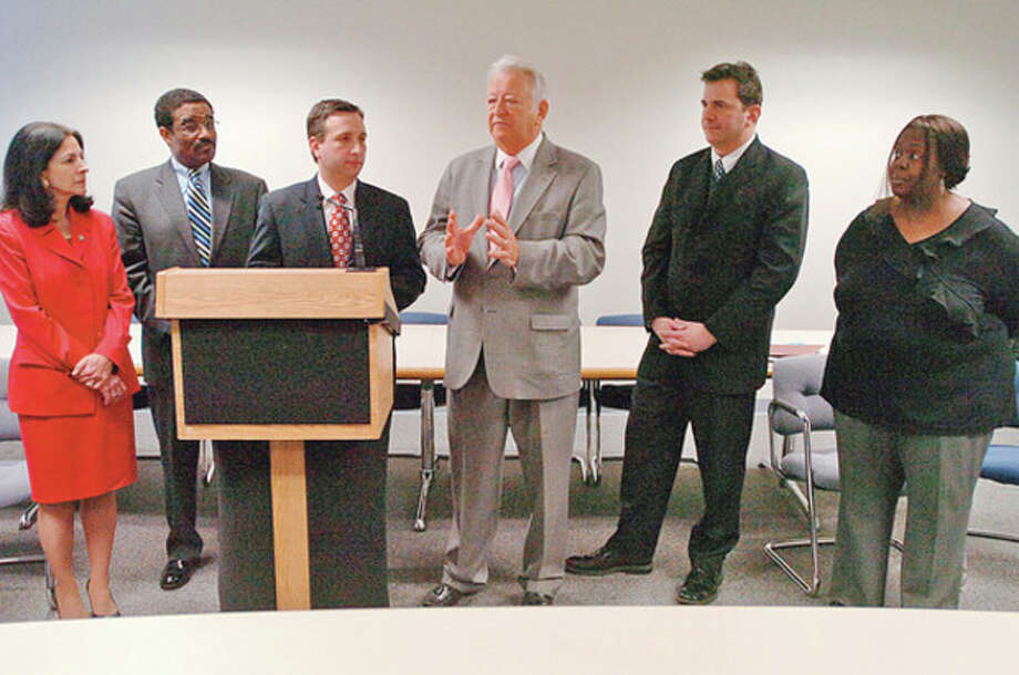 Hour photo / Erik Trautmann Norwalk Mayor Richard A. Moccia, center, holds a news conference at Norwalk City Hall with area legislators denouncing the recent events surrounding the federal audit of NEON's accounting practices. / (C)2011, The Hour Newspapers, all rights reserved