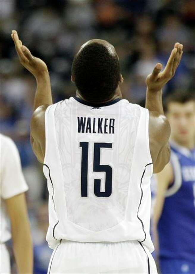 Connecticut's Kemba Walker reacts after his team beat Kentucky 556-55 at a men's NCAA Final Four semifinal college basketball game Saturday, April 2, 2011, in Houston. (AP Photo/David J. Phillip) / AP