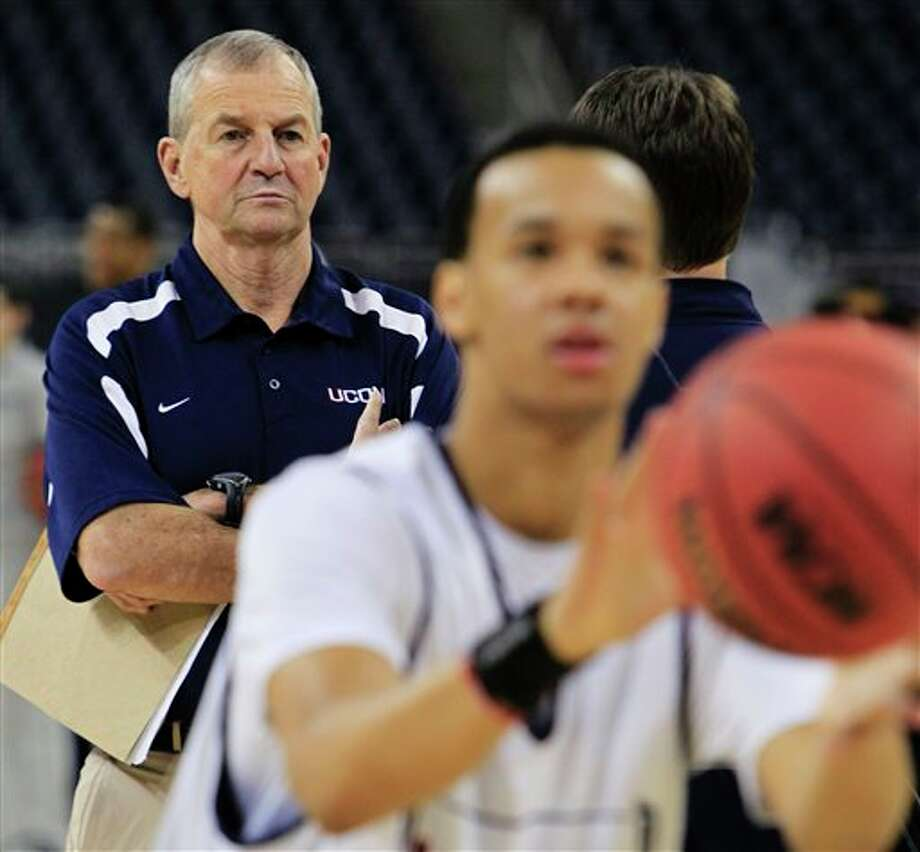 Connecticut head coach Jim Calhoun watches his team during a practice for a men's NCAA Final Four semifinal college basketball game Friday, April 1, 2011, in Houston. UConn plays Kentucky on Saturday. (AP Photo/Mark Humphrey) / AP