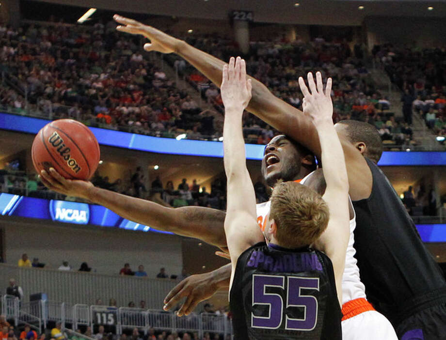 Syracuse's Dion Waiters, center, tries to shoot between Kansas State's Will Spradling (55) and Jordan Henriquez in the first half of an East Regional NCAA tournament third-round college basketball game on Saturday, March 17, 2012 in Pittsburgh. (AP Photo/Keith Srakocic) / AP