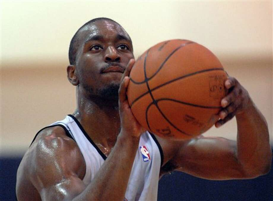 FILE - In this June 3, 2011 file photo, University of Connecticut's Kemba Walker shoots during pre-draft workout for the Charlotte Bobcats basketball team in Charlotte, N.C. For a guy considered undersized, Walker still managed to put the team on his back and carry UConn to the NCAA championship. Walker figures to be sitting at No. 3 when the Utah Jazz pick in Thursday's NBA draft. (AP Photo/The Charlotte Observer, Todd Sumlin, File ) / AP2011
