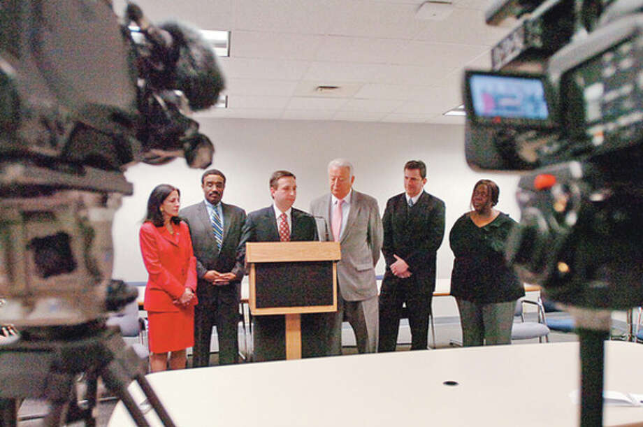State Senator Bob Duff speaks at a press conference with Norwalk mayor Richard Moccia, center, and other area legislators denouncing the recent events surrounding the federal audit of NEON's accounting practices.Hour photo / Erik Trautmann / (C)2011, The Hour Newspapers, all rights reserved