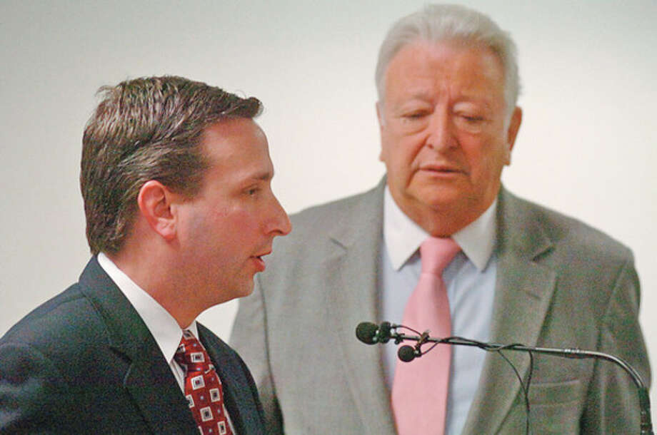 State Senator Bob Duff speaks at a press conference with Norwalk mayor Richard Moccia, center, and other area legislators denouncing the recent events surrounding the federal audit of NEON's accounting practices. Hour photo / Erik Trautmann / (C)2011, The Hour Newspapers, all rights reserved
