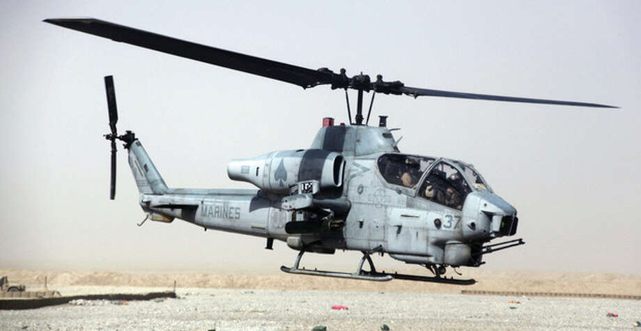 "AP photo / U.S. MarinesThis undated image provided by the U.S. Marines shows a AH-1W ""Cobra"" helicopter. Seven Marines were killed in a collision of two helicopters, one of them similar to this one, near Yuma, Ariz., during night training exercises Wednesday / US Marines"