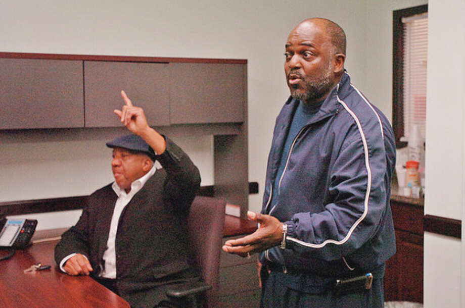 Norwalk residents Larry John son and John Mosby ask questions President of the Norwalk Opportunity Now (NEON) Board of Directors, Greg Burnett Jr. and Executive Director Joe Mann, address questions about a recent audit by the Office of the Inspector General during a press conference Thursday morning.Hour photo / Erik Trautmann / (C)2011, The Hour Newspapers, all rights reserved