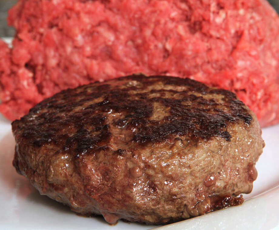 "A hamburger made from ground beef containing what is derisively referred to as ""pink slime,"" or what the meat industry calls ""lean, finely textured beef,"" is ready for tasting Thursday, March 15, 2012 in Concord, N.H. Under a change announced Thursday by the U.S. Department of Agriculture, districts that get food through the government's school lunch program will be allowed to say no to ground beef containing the ammonia-treated filler and choose filler-free meat instead. The low-cost filler is made from fatty meat scraps that are heated to remove most of the fat, then treated with ammonium hydroxide gas to kill bacteria such as E. coli and salmonella. (AP Photo/Jim Cole) / AP"