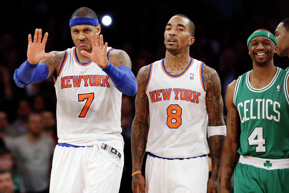 Boston Celtics guard Jason Terry (4) smiles as New York Knicks forward Carmelo Anthony (7) gestures to a referee and guard J.R. Smith (8) walks away after a play in the second half of their NBA basketball game at Madison Square Garden in New York, Monday, Jan. 7, 2013. The Celtics won 102-96. (AP Photo/Kathy Willens) / AP