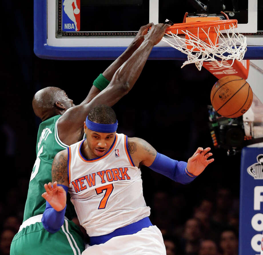 Boston Celtics forward Kevin Garnett (5) dunks against New York Knicks forward Carmelo Anthony (7) in the first half of their NBA basketball game at Madison Square Garden in New York, Monday, Jan. 7, 2013. (AP Photo/Kathy Willens) / AP