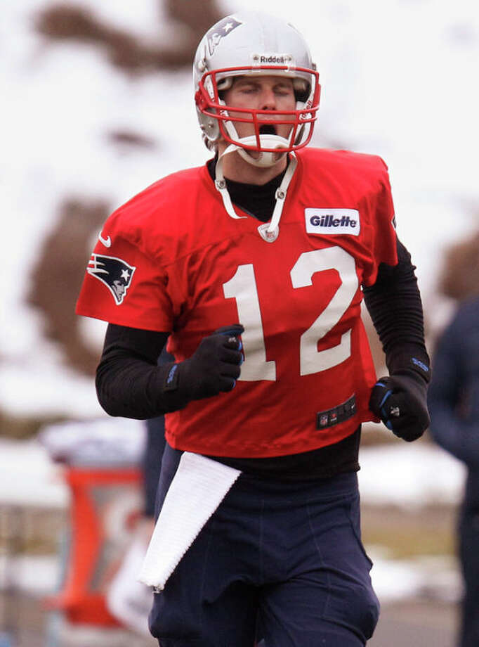 New England Patriots quarterback Tom Brady runs during practice at the team's NFL football facility in Foxborough, Mass., Wednesday, Jan. 9, 2013. The Patriots host the Houston Texans in an AFC divisional playoff game on Sunday. (AP Photo/Stephan Savoia) / AP