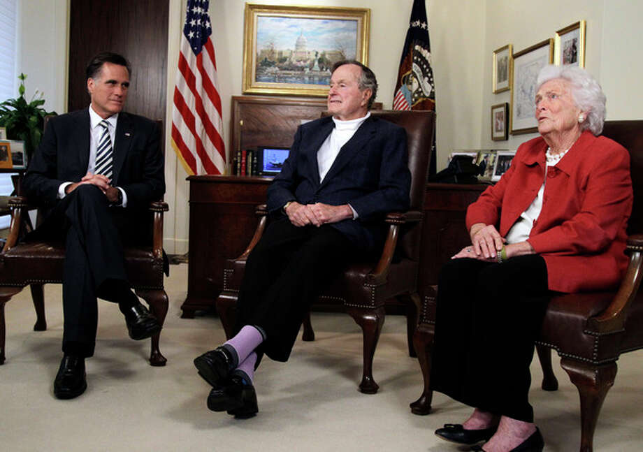 Republican presidential candidate and former Massachusetts Gov. MittRomney, left, meets with former President George H.W. Bush and Barbara Bush to receive their endorsements Thursday, March 29, 2012, in Houston. (AP Photo/Pat Sullivan) / AP