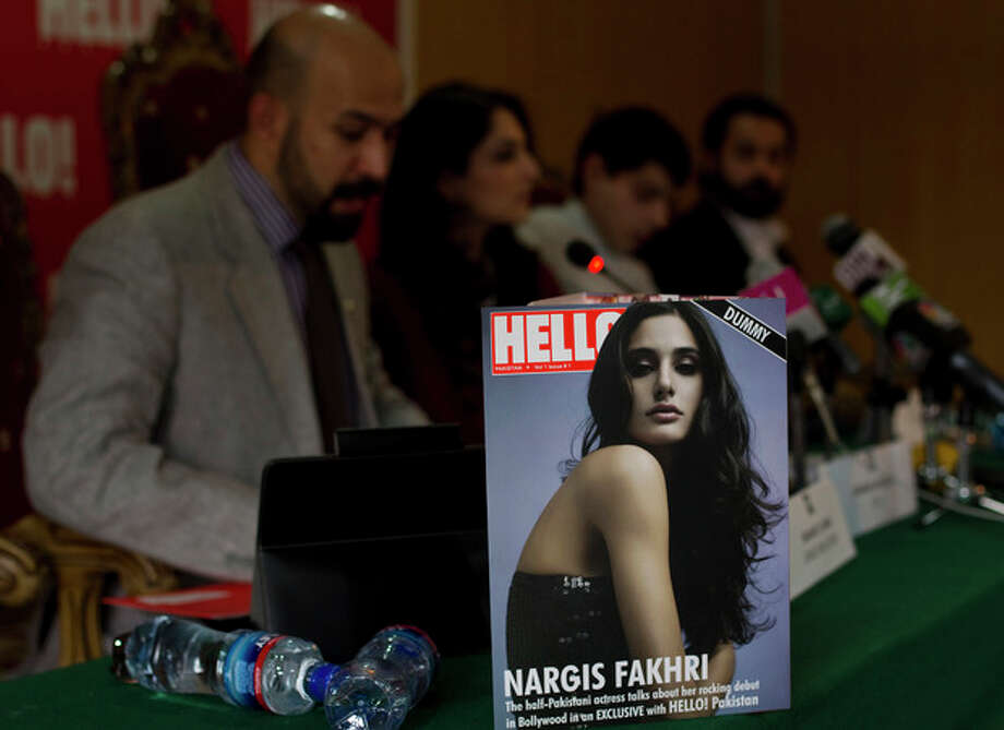 The editorial staff of Hello magazine address a news conference during its launching ceremony at National Press Club in Islamabad, Pakistan on Saturday, March 24, 2012. Pakistan is better known for bombs than bombshells, militant compounds than opulent estates. A few enterprising Pakistanis hope with the launch of a local version of the well-known celebrity magazine Hello! (AP Photo/B.K. Bangash) / AP