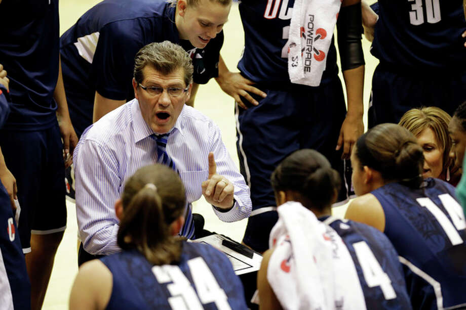 Connecticut head coach Geno Auriemma talks to his team during a timeout in the first half of an NCAA college basketball game against Georgetown, Wednesday, Jan. 9, 2013, in Washington. (AP Photo/Alex Brandon) / AP