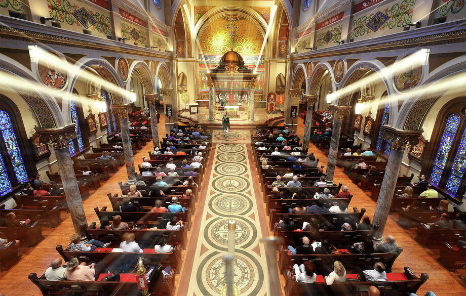 A larger than normal attendance showed Monday morning  at the St. Anthony Cathedral Basilica to pray and for a special dedication to the victims of the Orlando shooting. Several catholics and non-catholics attended the service. Photo taken Monday, June 13, 2016 Guiseppe Barranco/The Enterprise Photo: Guiseppe Barranco, Photo Editor