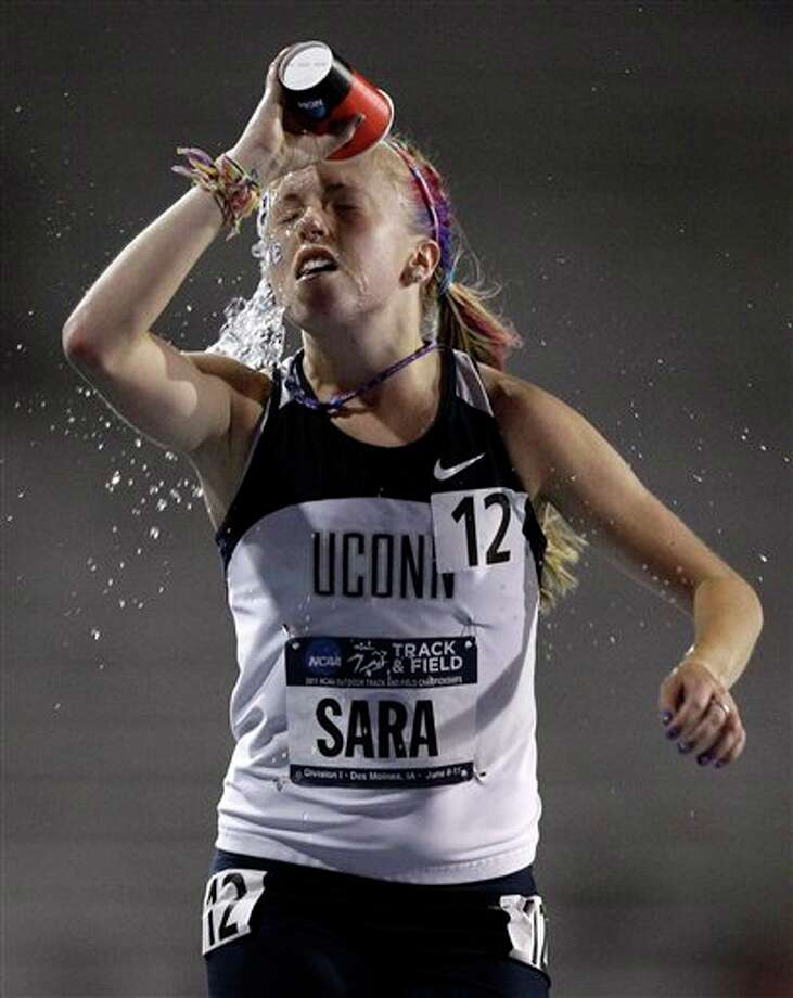 Connecticut's Lauren Sara cools off during the women's 10,000 meter run at the NCAA outdoor track and field championships, Wednesday, June 8, 2011, at Drake Stadium in Des Moines, Iowa. (AP Photo/Charlie Neibergall) / AP