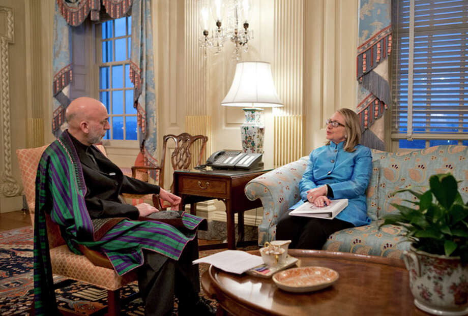 Secretary of State Hillary Rodham Clinton meets with Afghanistan President Hamid Karzai, left, at the State Department in Washington, Thursday, Jan. 10, 2013. (AP Photo/J. Scott Applewhite) / AP