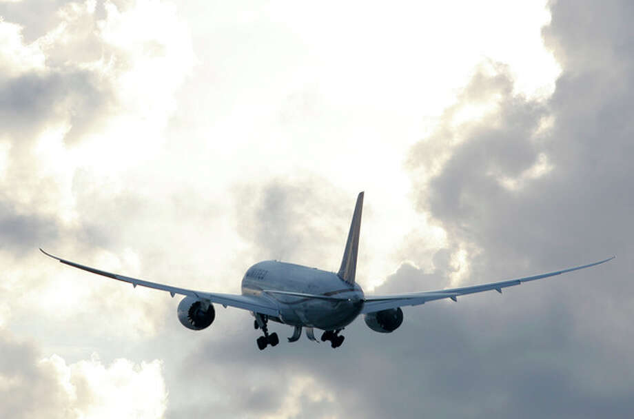 FILE PHOTO - In this Nov. 4, 2012 file photo, a Boeing 787 takes off. / Houston Chronicle