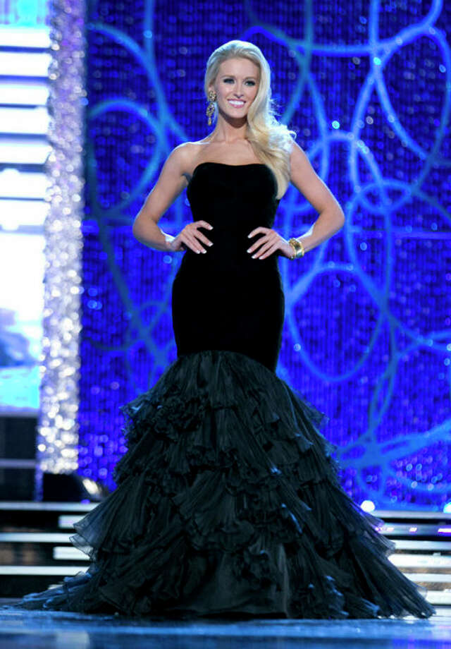 This photo courtesy Miss America Organization shows Miss DC, Allyn Rose, during the Evening Wear portion of preliminary competition at the 2013 Miss America Pageant in Las Vegas, Tuesday, Jan. 8, 2013. Win or lose, Saturday's Miss America competition will be Rose's last pageant. The 24-year-old plans to undergo a double mastectomy after the event as a preventative measure to reduce her chances of developing the disease that killed her mother, grandmother and great aunt. (AP Photo/Courtesy Miss America Organization) / Miss America Organization