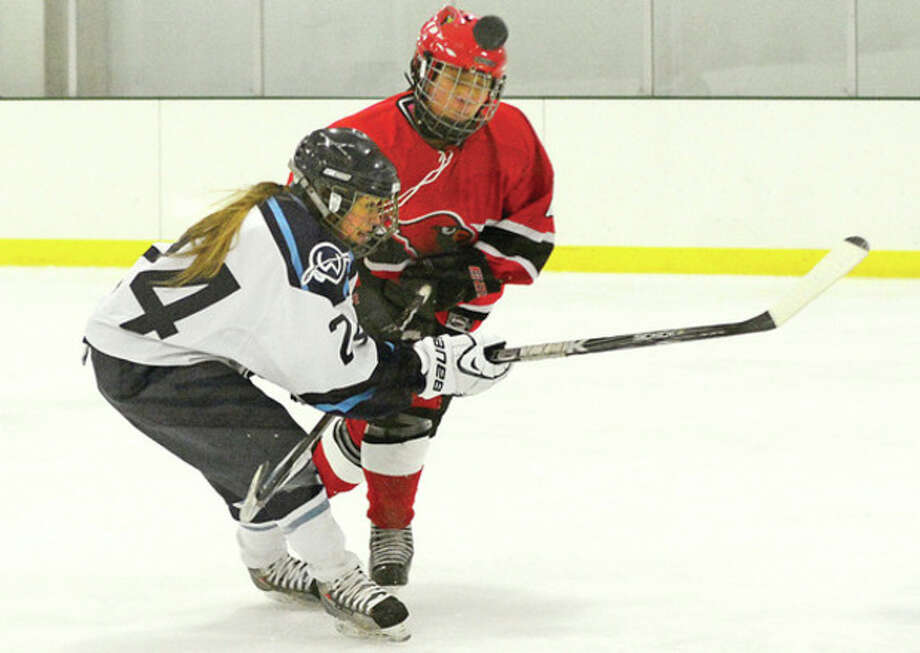 #24 Sam Enborg tries to get through Greenwich's Monica Stevenson during their game against Greenwich Saturday.Hour photo / Erik Trautmann / (C)2012, The Hour Newspapers, all rights reserved