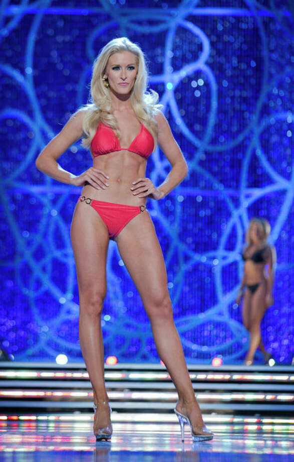 This photo courtesy Miss America Organization shows Miss DC, Allyn Rose, during the Swimsuit portion of preliminary competition at the 2013 Miss America Pageant in Las Vegas, Tuesday, Jan. 8, 2013. Win or lose, Saturday's Miss America competition will be Rose's last pageant. The 24-year-old plans to undergo a double mastectomy after the event as a preventative measure to reduce her chances of developing the disease that killed her mother, grandmother and great aunt. (AP Photo/Courtesy Miss America Organization) / Miss America Organization