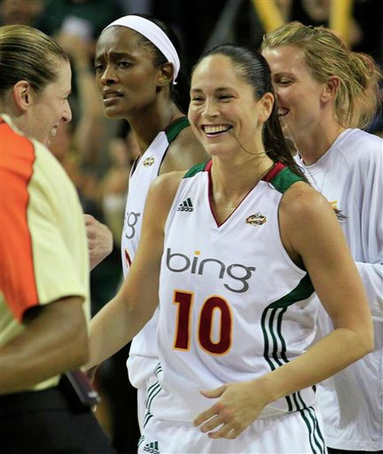 Seattle Storm's Sue Bird smiles after the team beat the Connecticut Sun in a WNBA basketball game Friday, Aug. 5, 2011, in Seattle. The Storm won 81-79, on a last-second 3-point shot by Bird. (AP Photo/Elaine Thompson) / AP