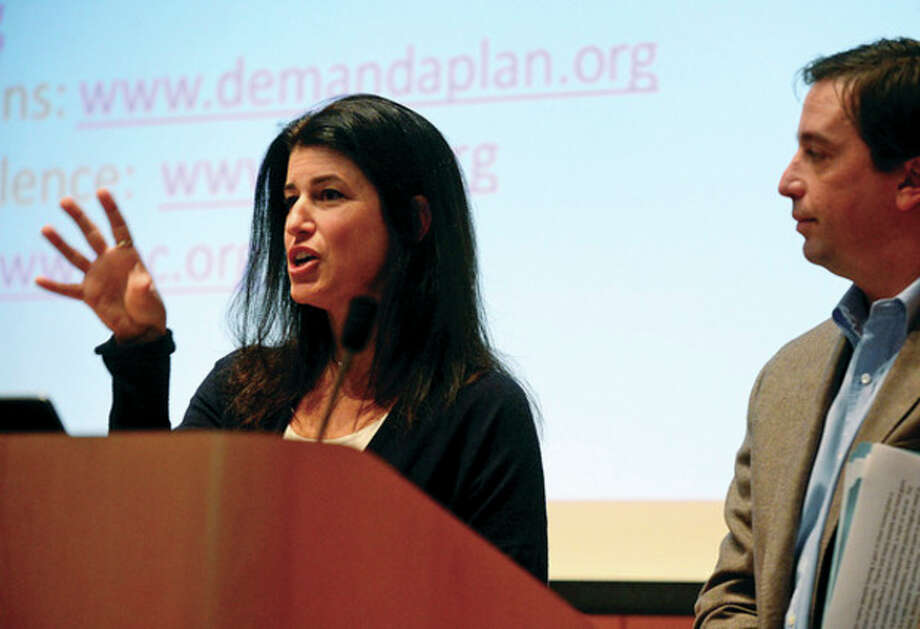 Hour photo / Erik TrautmannWilton residents for tighter gun legislation Lucy Davies and Harrison DeStefano speak at the Wilton Domestic Violence Task Force meeting to discuss gun legislation and violence against women at the Wilton library Thursday. / (C)2012, The Hour Newspapers, all rights reserved