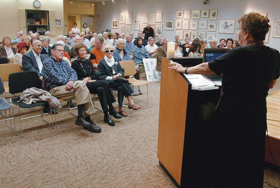 Estelle Margolis, wife of the late activist Manny Margolis, addresses the crowd at the Westport Public Library that turned out to honor Margolis who died in August. / (C)2011, The Hour Newspapers, all rights reserved