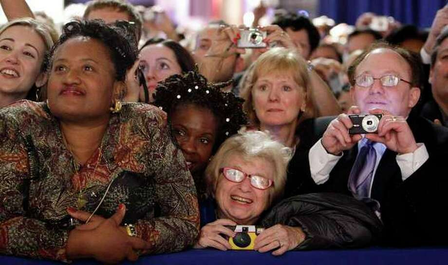 FILE - Dr. Ruth Westheimer, center, in the front-row watches President Barack Obama and first lady Michelle Obama at the Western Inaugural Ball in Washington, in this Jan. 20, 2009 file photo. The sideline events throughout inauguration weekend are the big draws for advocates and lobbyists looking to rub elbows with lawmakers and administration officials. The events at restaurants and hotels, museums and mansions are opportunities for anyone willing to write a check to turn a night out into a chance to build a Rolodex of Washington's powerbrokers. (AP Photo/Pablo Martinez Monsivais, File) / ap