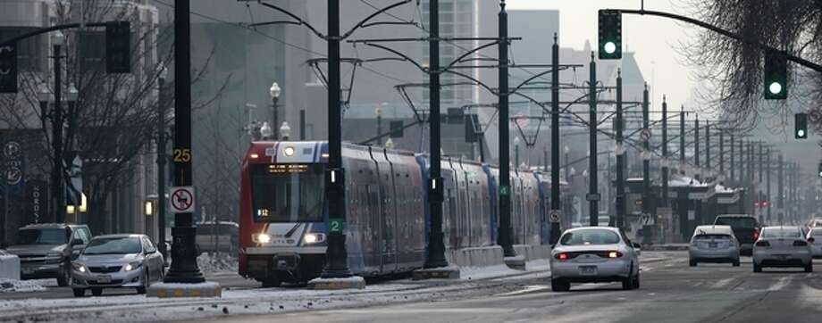 The light rail travels in downtown Salt Lake City Wednesday, Jan. 9, 2013. Built with the 2002 Winter Olympics in mind, Salt Lake City's light-rail network is free for passengers as it weaves through downtown. Riders can get to and from major attractions such as Temple Square, City Creek Center, Salt Lake City Library, Energy Solutions Arena and the Gateway for free. (AP Photo/Rick Bowmer) / AP