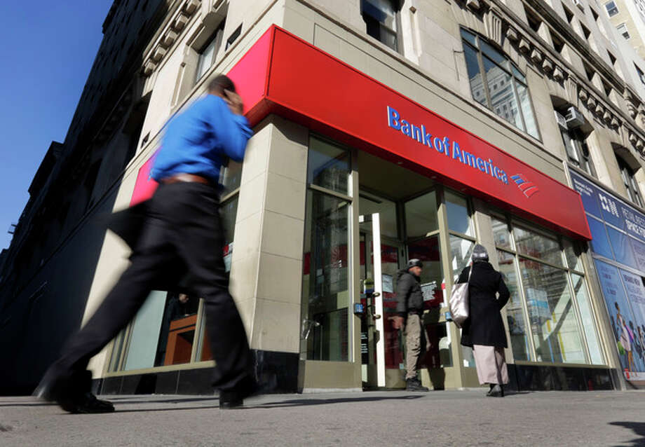 People pass a Bank of America brach, in New York, Monday, Jan. 7, 2013. Bank of America will pay $10.3 billion to the government mortgage agency Fannie Mae to settle claims resulting from mortgage-backed investments that soured during the housing crash. (AP Photo/Richard Drew) / AP
