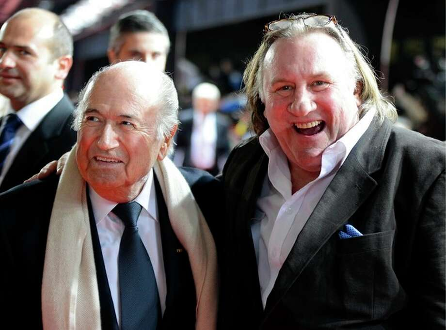 "FIFA President Joseph ""Sepp"" Blatter, left, and French-Russian actor Gerard Depardieu, right, arrive for the FIFA Ballon d'Or Gala 2013 held at the Kongresshaus in Zurich, Switzerland, on Monday, Jan. 7, 2013. French actor Gerard Depardieu has received a Russian passport after he sought Russian citizenship as part of his battle against a proposed super tax on millionaires in France. (AP Photo/Keystone/Walter Bieri) / KEYSTONE"