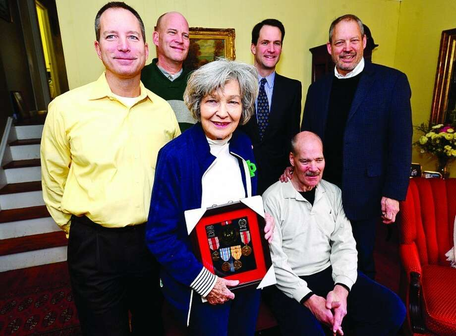 Kathleen Schaffer and her four sons, Peter, Kevin, cott and Jack with US Congressman Jim Himes, as Himes delivers eight military service medals to the widow of late U.S. Army Sgt. Clarence Schaffer Jr., Kathleen Schaffer, recognizing the World War II veteran's service as a member of the Parachute Infantry Regiment during a brief ceremony at the Schaeffer home Tuesday morning. Hour photo / Erik Trautmann