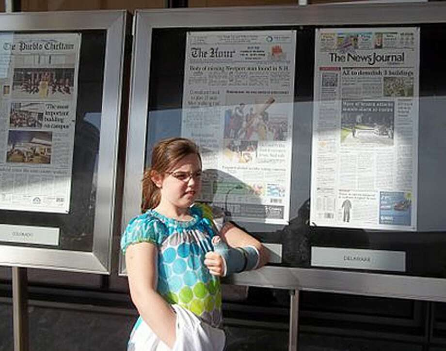 Pablo Aymerich of Norwalk snapped this photo of his daughter Erin Aymerich, 10, a Naramake School student, during a recent trip to Washington DC. The family visited Newseum and The Hour was one of the featured newspapers that day. Newseum is a museum dedicated to newspapers.