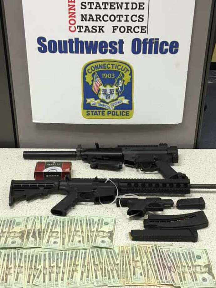 Weapons seized in a raid on a Bridgeport apartment on Monday, June 13 include a GSG-522 .22 caliber rifle w/pistol grip and silencer - classified as an assault weapon -- aSmith & Wesson M&P 15-22 .22 caliber rifle reported stolen out of South. Carolina and a Glock Model 26 9mm semi-automatic handgun with a high capacity magazine Photo: Contributed Photo