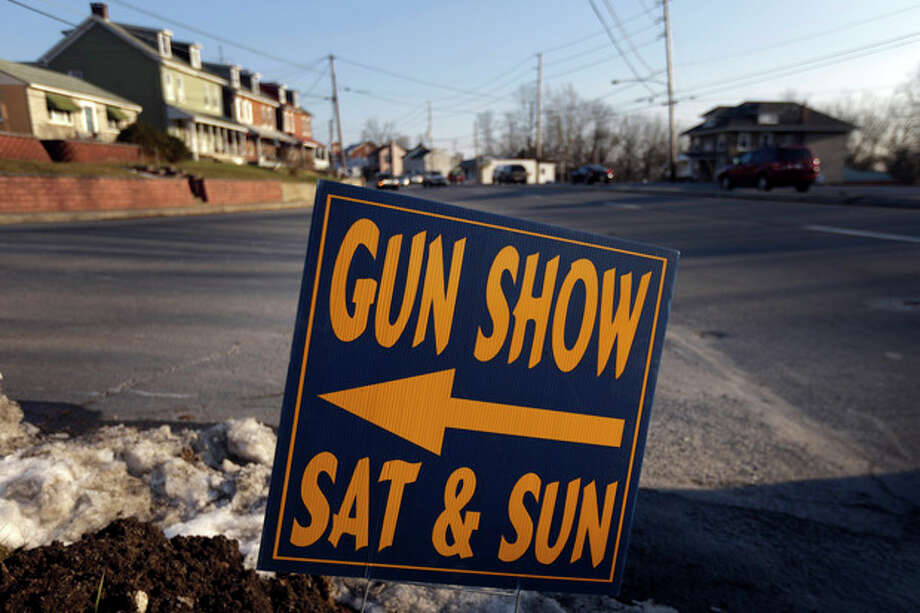 A sign is posted for an upcoming gun show, Friday, Jan. 4, 2013, in Leesport, Pa. Gun advocates arenít backing down from their insistence on the right to keep and bear arms. But heightened sensitivities and raw nerves since the Newtown, Conn. shooting are softening displays at gun shows and even leading officials and sponsors to cancel the popular exhibitions altogether. (AP Photo/Matt Rourke) / AP