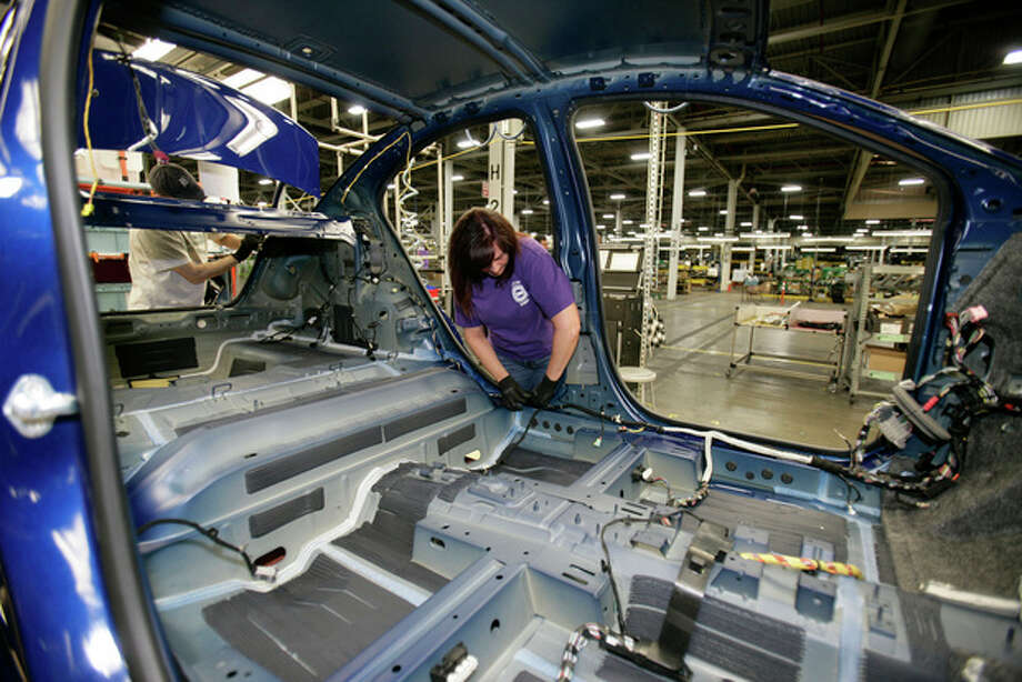 AP photoTammy Ballard works on a Chevrolet Sonic at the General Motors Orion Assembly plant in Orion Township, Mich. Nearly four years after GM filed for bankruptcy protection, the automaker is building the Sonic, the best-selling subcompact car in the nation. / FR38952 AP