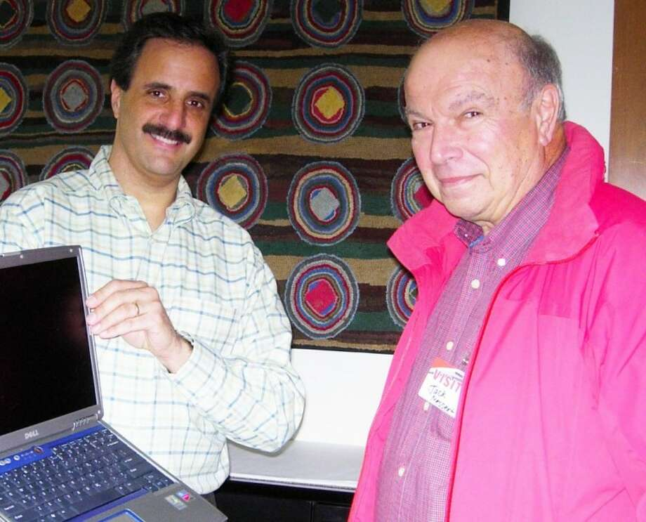 Connolly Audit Support Center in Wilton donated five used laptop computers to New Canaan's Schoolhouse Apartments