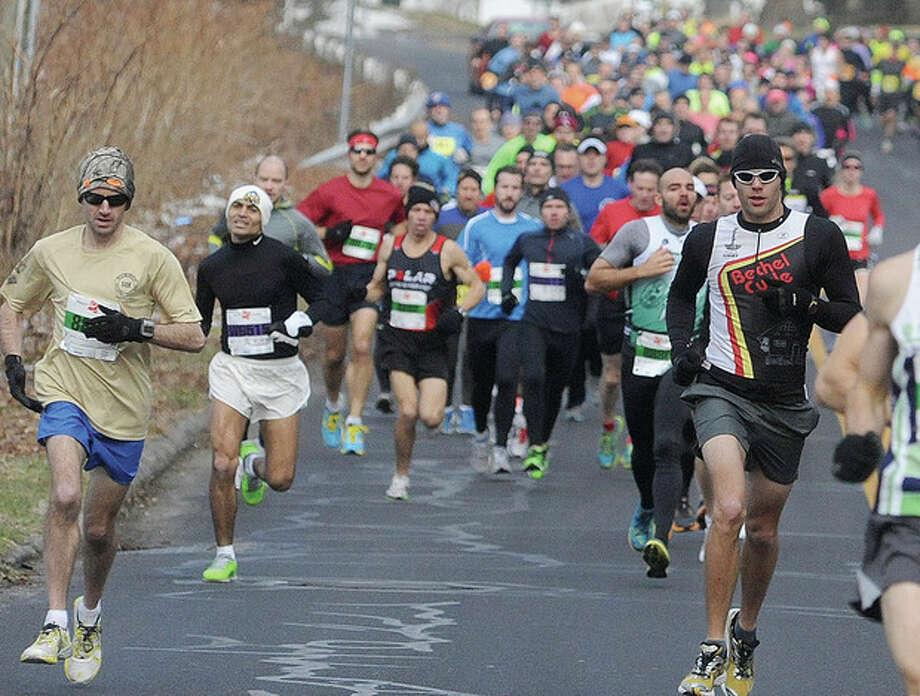 The Boston Buildup race makes it's way through Rowayton on Sunday. Hour photo/Matthew vinci