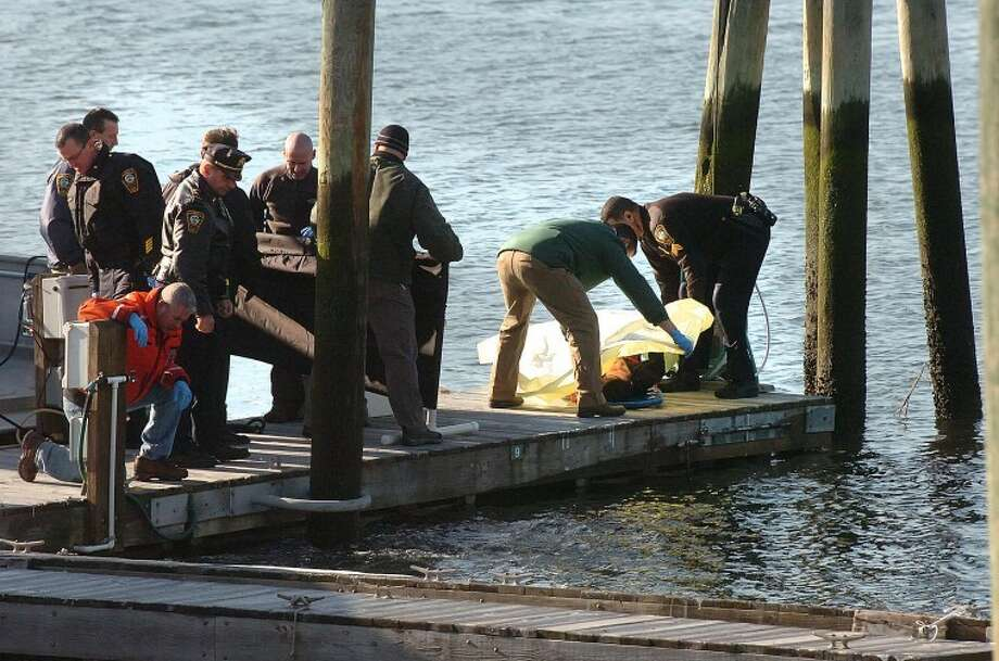 Hour Photo/Alex von Kleydorff. Norwalk police and detectives remove a body from the Norwalk River on Monday morning