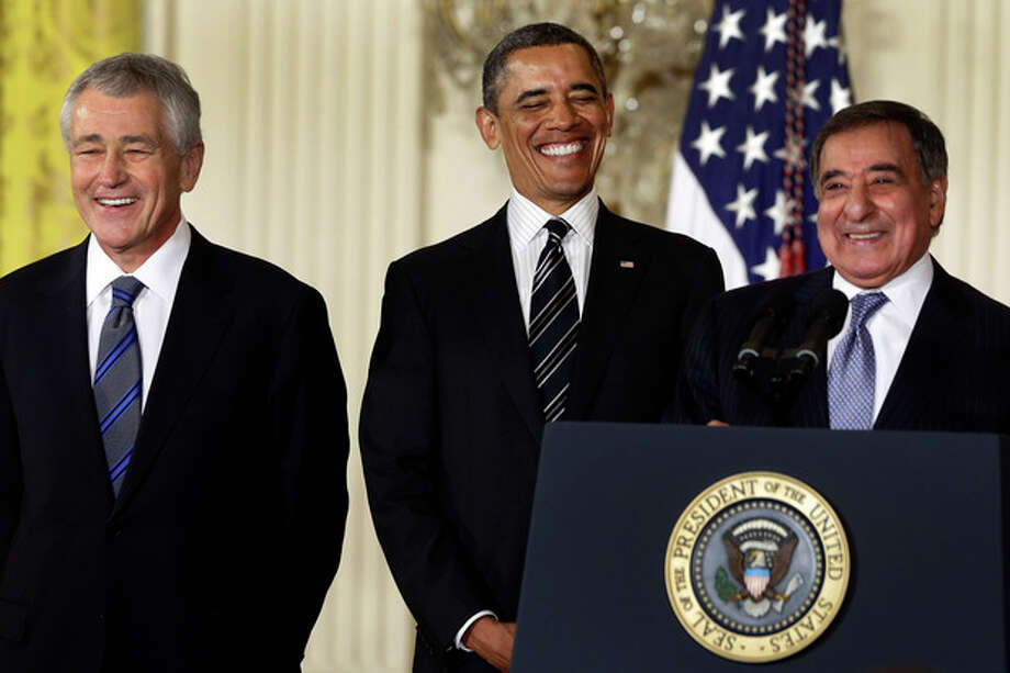 AP Photo/Charles DharapakPresident Barack Obama and his choice for Defense Secretary, former Nebraska Sen. Chuck Hagel, left, laugh as current Defense Secretary Leon Panetta speaks in the East Room of the White House in Washington, Monday, Jan. 7, where the president announced his nomination of Hagel. / AP
