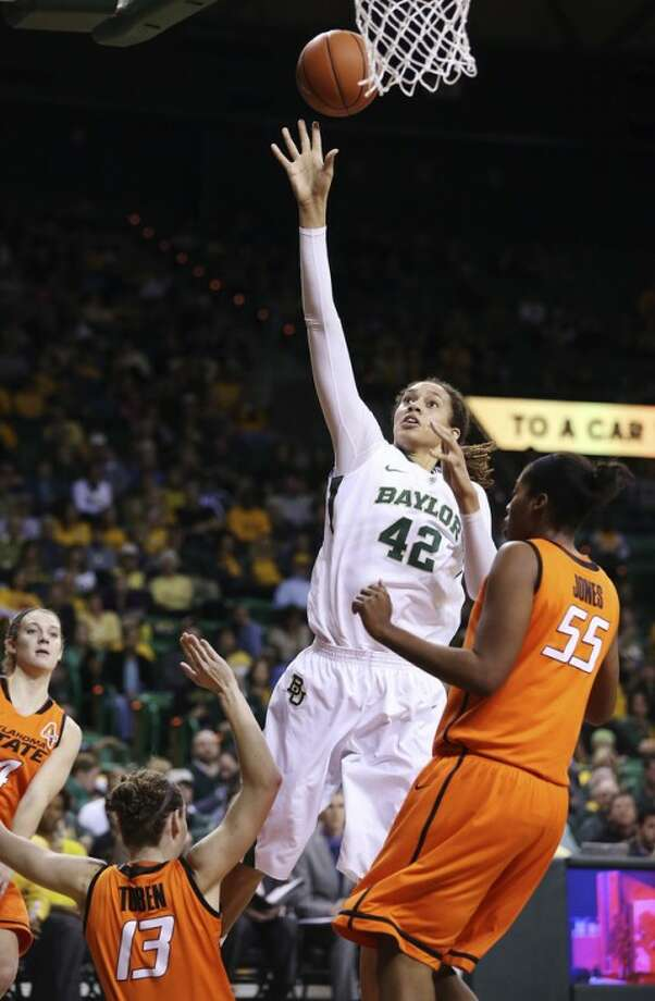 Baylor's Brittney Griner (42), shoots past Oklahoma State's Morgan Toben (13) and LaShawn Jones (55) during the second half of their NCAA college basketball game, Sunday, Jan. 6, 2013, in Waco, Texas. Baylor won 83-49. (AP Photo/The Waco Tribune-Herald, Rod Aydelotte)